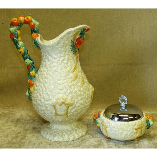 46 - A Clarice Cliff Harvest Pattern Bulbous Jug, 28cm high, also a similar Jam Pot having metal cover (3...