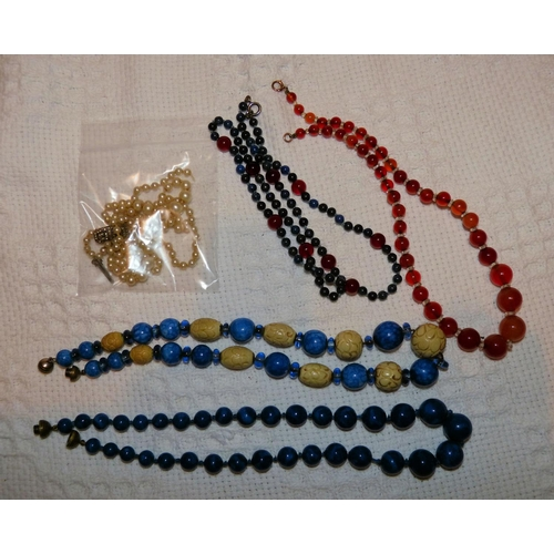 464 - 4 Various Bead Necklaces and a similar pearl style necklace (5)...