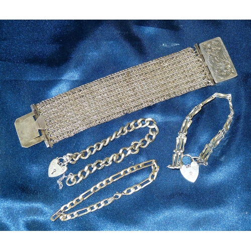 466 - A Silver Bracelet having padlock clasp another silver gate bracelet with padlock clasp, another silv...