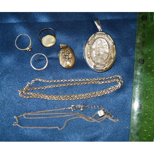 467 - A Silver Linked Chain, 3 silver rings another silver chain with pendant and 2 silver lockets...