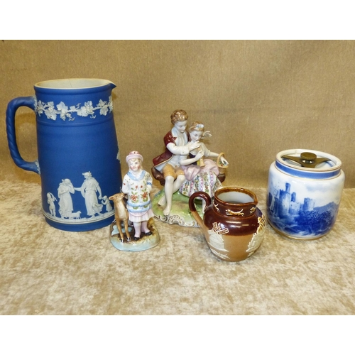 47 - A Wedgwood Jasperware Round Jug on white and blue ground with raised classical figure, grape and vin...