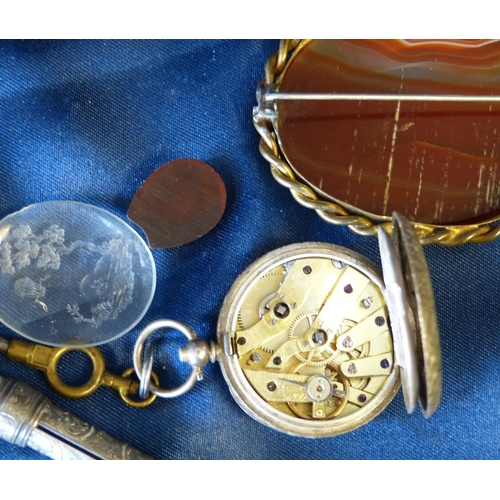 470 - A Silver Fob Watch having chased decoration, a silver pendant, an agate silver brooch, 2 oval seals ...