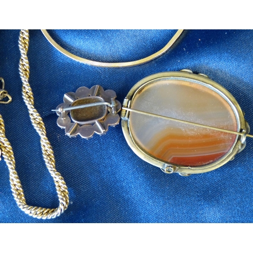 472 - An Oval Moss Agate Brooch, a Coral Small Brooch, 2 chains and a bangle (5)...