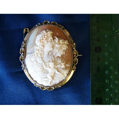 473 - An Oval Large Cameo Brooch having raised figurehead and cupid motif, framed (cracked)...