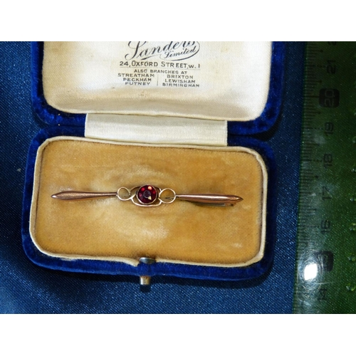 475 - A 9ct Gold Bar Brooch set with centre red stone...