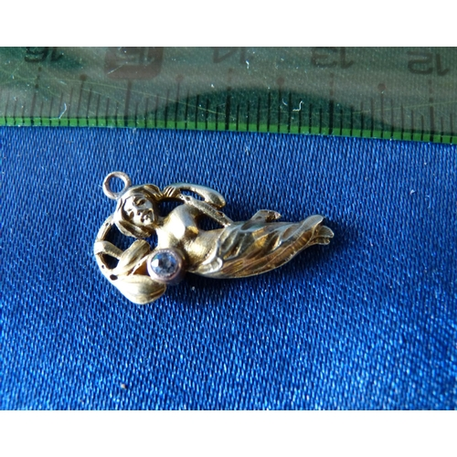 483 - An 18ct Gold Small Pendant in form of half naked lady inset with small diamond, 2.4gms...