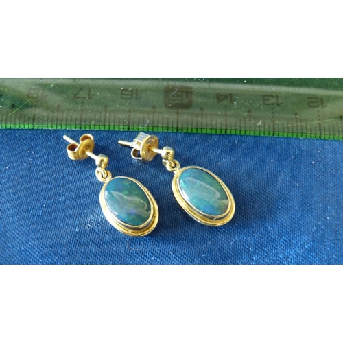 484 - A Pair of 18ct Gold Drop Opal Earrings...