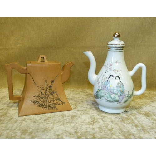 50 - An Oriental Earthenware Square Teapot having engraved building and inscription decoration, 11.5cm hi...