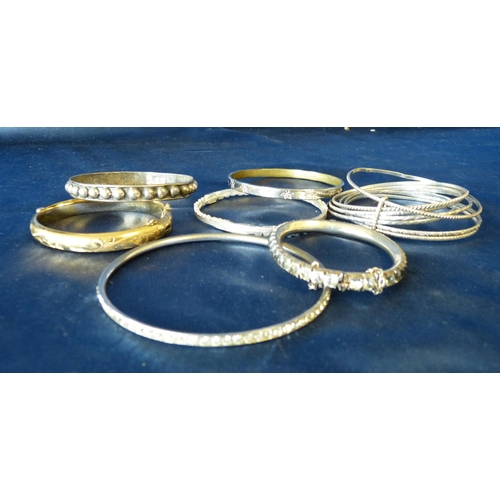 505 - A 925 Silver Bangle having raised ball motifs and a quantity of various other bangles...