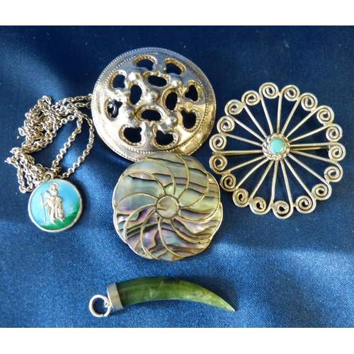 512 - A Silver Round Scalloped Pierced Brooch having centre green stone, 2 other silver brooches and 2 sli...