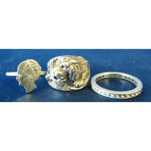 513 - A Silver Ring having embossed and pierced lion motif, also 2 other rings (3)...