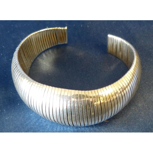 514 - A 925 Silver Bulbous Shape Bangle having reeded decoration...