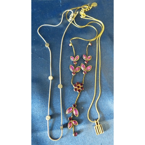 515 - A Floral Drop Necklace mounted with purple stones, also 2 other necklaces...