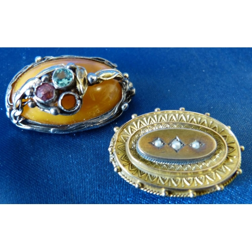 518 - An Oval Gold Brooch mounted with 3 half pearls (stick missing) also another oval brooch having raise...