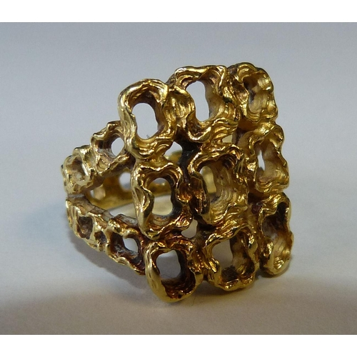 521 - An 18ct Gold Ring having all over pierced decoration, 12.1 gms...