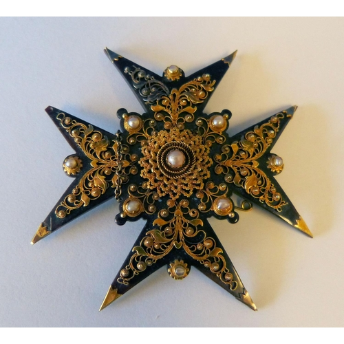 522 - A Tortoiseshell and Gold Mounted Cross Brooch having raised half pearl motifs...