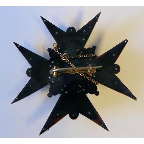 522 - A Tortoiseshell and Gold Mounted Cross Brooch having raised half pearl motifs...