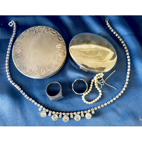 525 - A Silver Ring depicting various symbols, another ring, a paste drop necklace and 2 compacts...