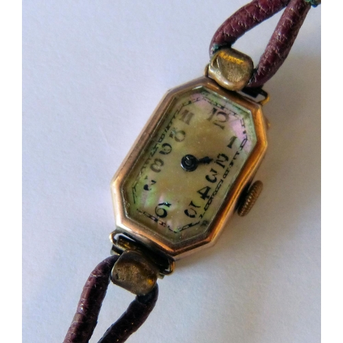 541 - A 9ct Gold Ladies Wrist Watch having rectangular chamfer dial with Arabic numerals and leather strap...
