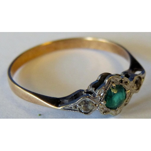 545 - A Gold Ring set with centre green stone...