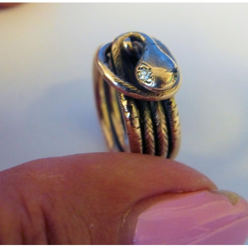 546 - A Gold Serpent Ring, 8.6gms...