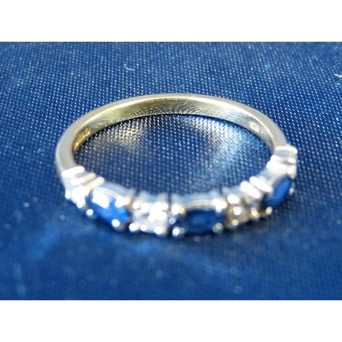552 - An 18ct Gold Ladies Ring set with 3 sapphires interspersed by 4 small diamonds...