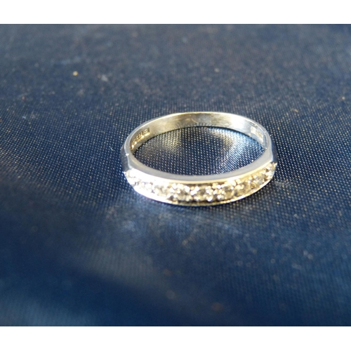 555 - An 18ct White Gold Half Eternity Ring set with 9 diamonds...