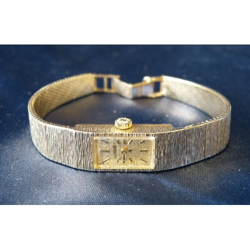 558 - A Ladies Longines 9ct Gold Wrist Watch with matching strap bracelet, weighable gold 23.3gms...