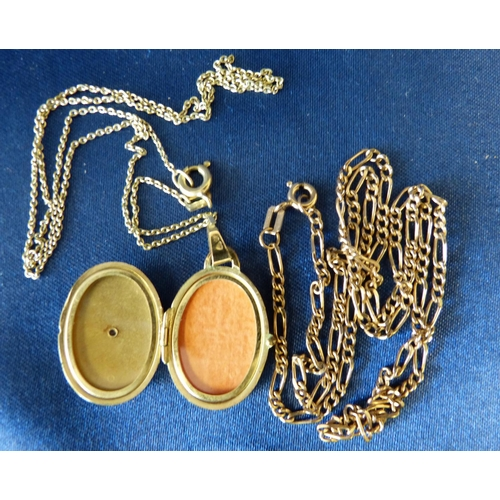 563 - A 9ct Gold Oval Locket with matching chain, also another 9ct gold chain 11.6gms gross...