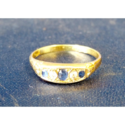 567 - An 18ct Gold Ladies Ring set with 3 sapphires interspersed by 2 small diamonds, ring size V/W...