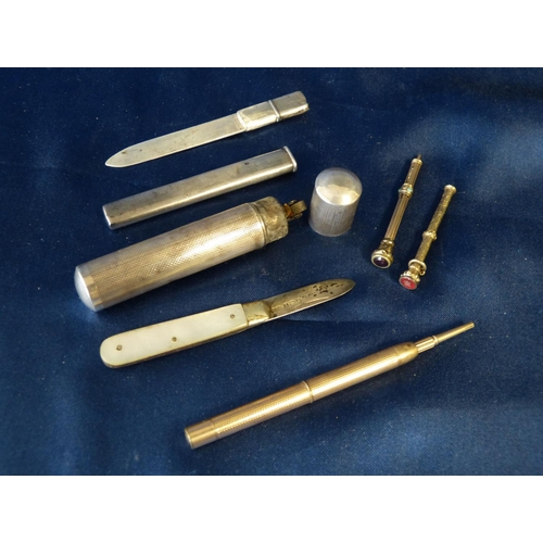 579 - A Sterling Silver Cylindrical Lighter, a silver paper knife, a silver and mother of pearl pen knife ...