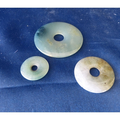 590 - 3 Oriental Jade Round Graduated Pendants with centre holes...