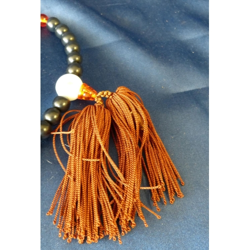 591 - An Oriental Black Bead Bracelet with tassel...