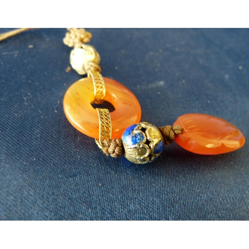 592 - An Oriental Drop Stone Gilt Metal and Blue Enamelled Pendant...