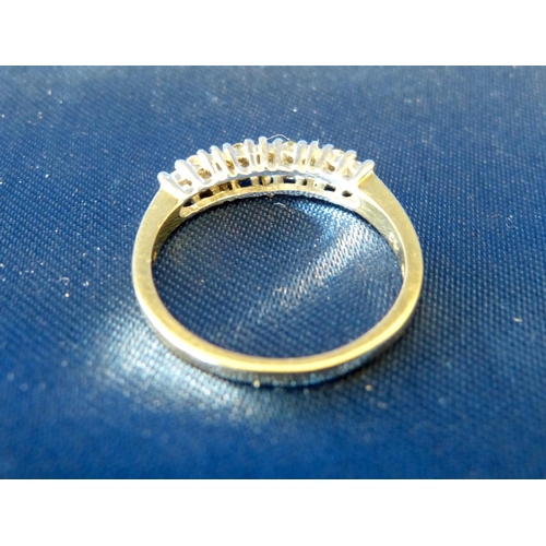 597 - A 9ct Gold Ladies Ring set with 13 small diamonds, ring size p/q...