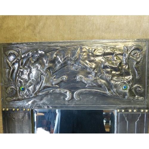 607 - An Arts and Crafts Pewter Bevelled Hanging Wall Mirror with embossed fish motifs having glass eyes w...