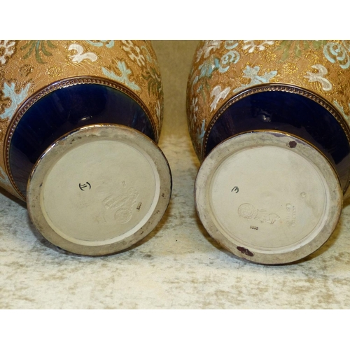 62 - A Pair of Royal Doulton Glazed Earthenware Bulbous Trumpet Shape Vases on blue and brown ground havi...