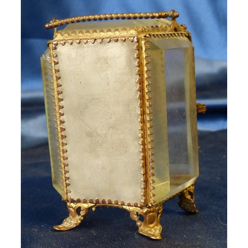 620 - A Gilt Metal and Bevelled Glass Night Watch Stand having swing overhead handle on splayed feet, hing...