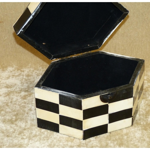 637 - A Reproduction Black and White Parquetry Hexagonal Tea Caddy having hinged lid, 20cm wide...