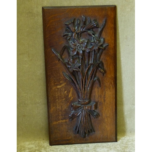 644 - A Carved Oak Panel having raised bunch of flowers, 53cm x 27cm...