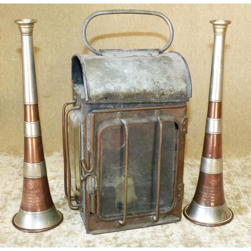 651 - Kohler & Son, London 2 Copper and Metal Bugles, also a lantern (3)...