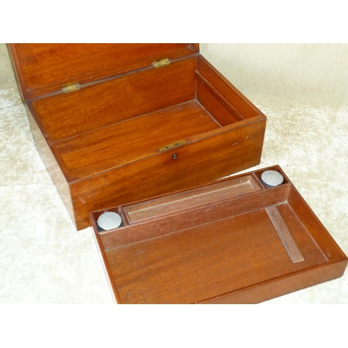 657 - A Mahogany Rectangular Box having hinged lid enclosing inkwells and tray interior, 38cm wide...