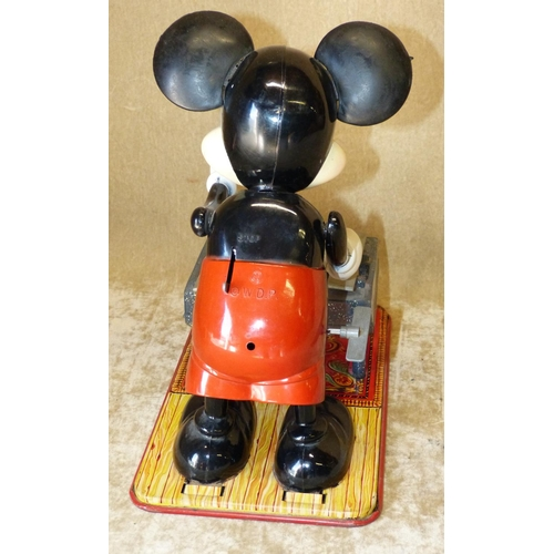 659 - A Tin and Plastic Key Wind Model of Mickey Mouse, 29cm high...