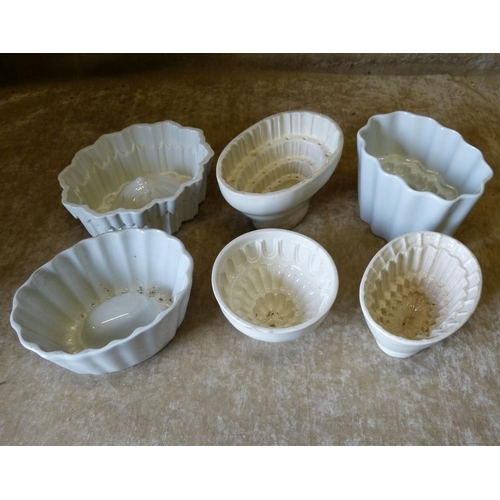 66 - A Shelley White China Oval Scalloped Jelly Mould, 18.5cm wide, also 5 other white china jelly moulds...