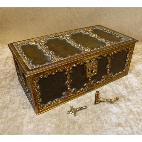 669 - A Gilt Metal and Leather Jewellery Casket having raised floral and scroll decoration, hinged lid enc...