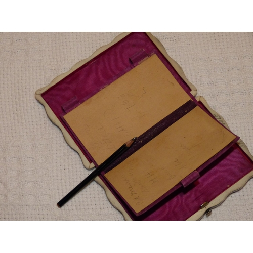676 - A 19th Century Tortoiseshell Rectangular Scalloped Notepad having hinged front enclosing fitted silk...