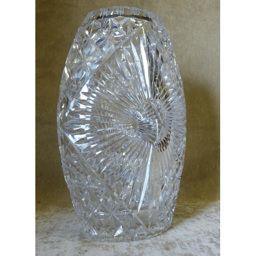 68 - An Oval Heavy Cut Glass Vase having all over tooth cut and thumb pattern decoration, 30cm high...