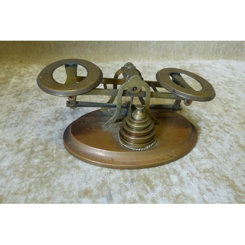 681 - A Set of Oval Brass Balance Scales with 5 graduated weights...