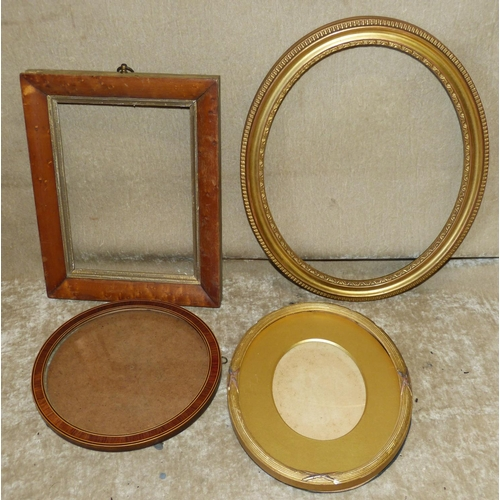 683 - A Circular Mahogany and Inlaid Frame. a walnut small frame and 2 other oval gilt frames (4)...