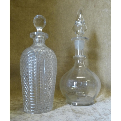 69 - A Cut Glass Bulbous Thin Neck Decanter with stopper having tooth cut decoration, 25cm high, also ano...